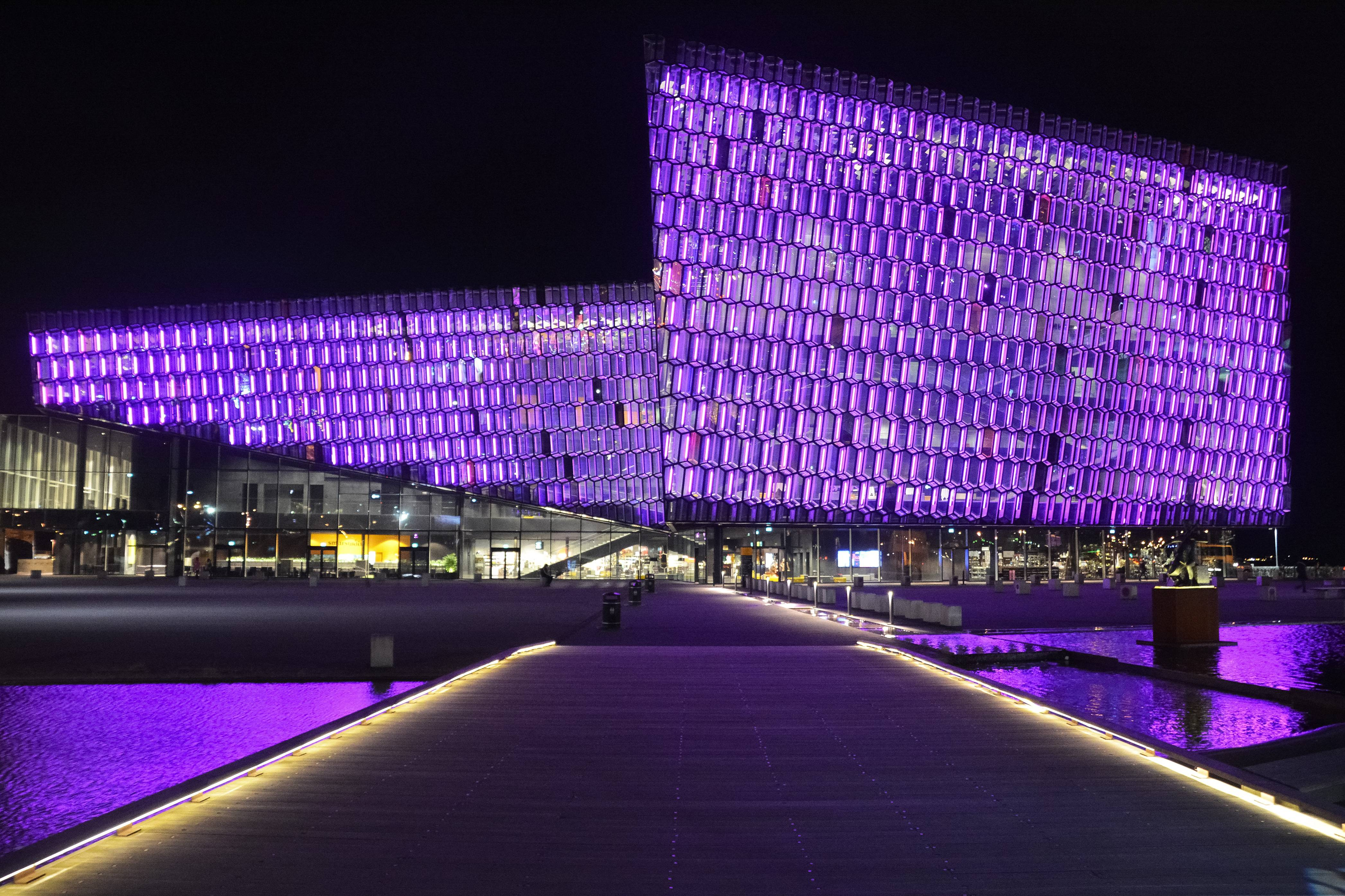 Harpan-concert-hall-in-down-town-reykjavik-in-purple-lights-at-night