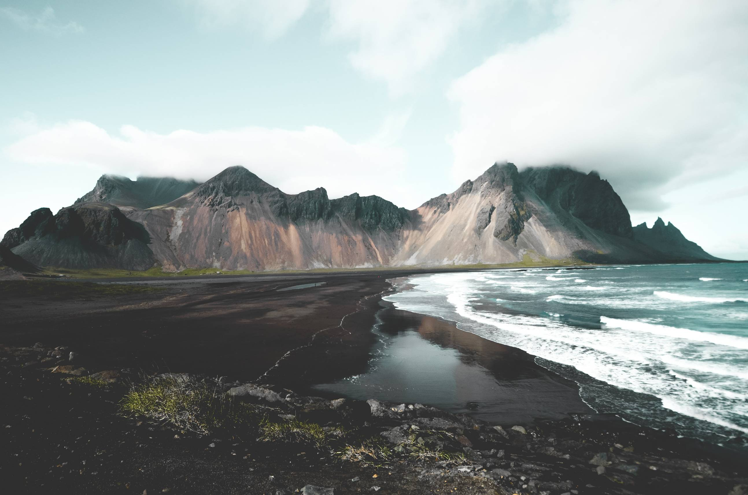 black-sand-beach-with-mount-vestrahorn-in-the-background-on-a-cloudy-day