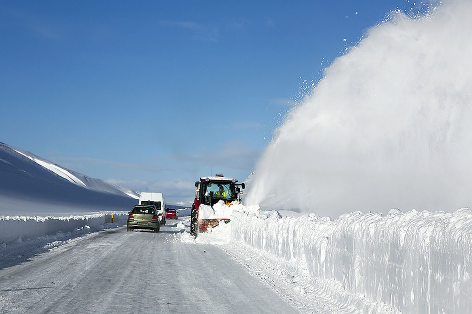 Snow plowing snow on road in iceland